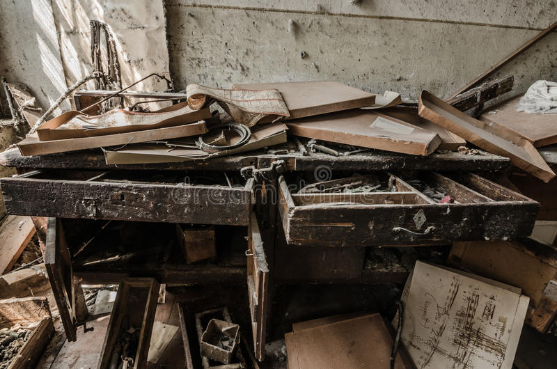 Desk with documents in factory. Desk with many documents in an old factory royalty free stock images