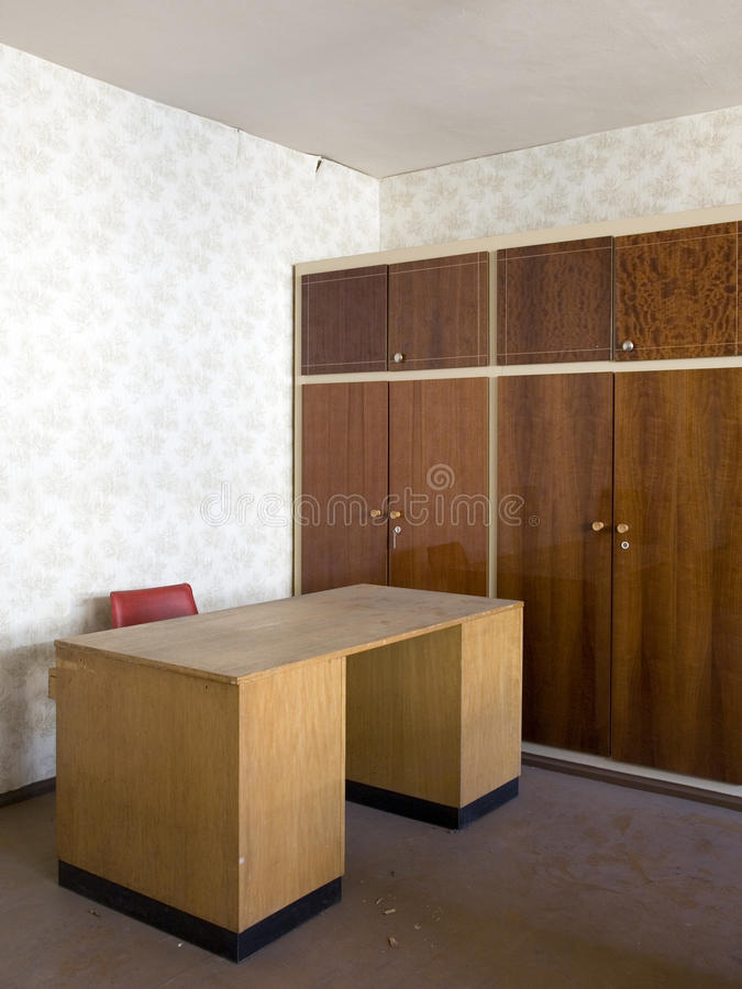 Desk in an empty office. Old wooden desk and storage cabinets in an office stock photography