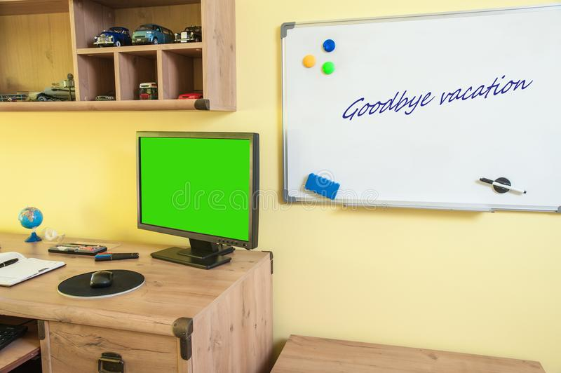 Desk with equipment for schools and whiteboard. Desk with equipment for school with computer for better your education royalty free stock photography