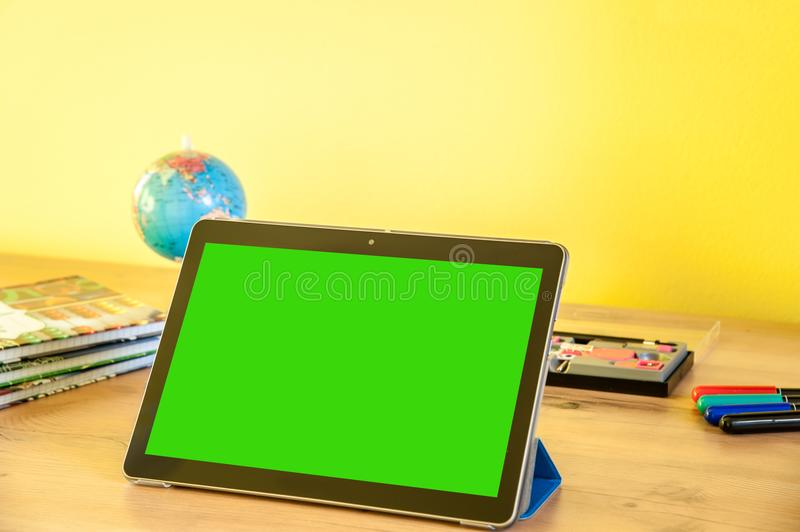 Desk with equipment for school and the tablet for better education.  royalty free stock photography