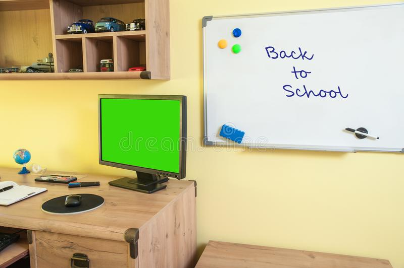 Desk with equipment for schools and whiteboard. Desk with equipment for school with computer for better your education stock photography