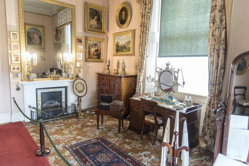 Desk and fireplace in Osborne House Isle of Wight. Osborne House is a former royal residence in East Cowes, Isle of Wight, United Kingdom. The house was built stock photos