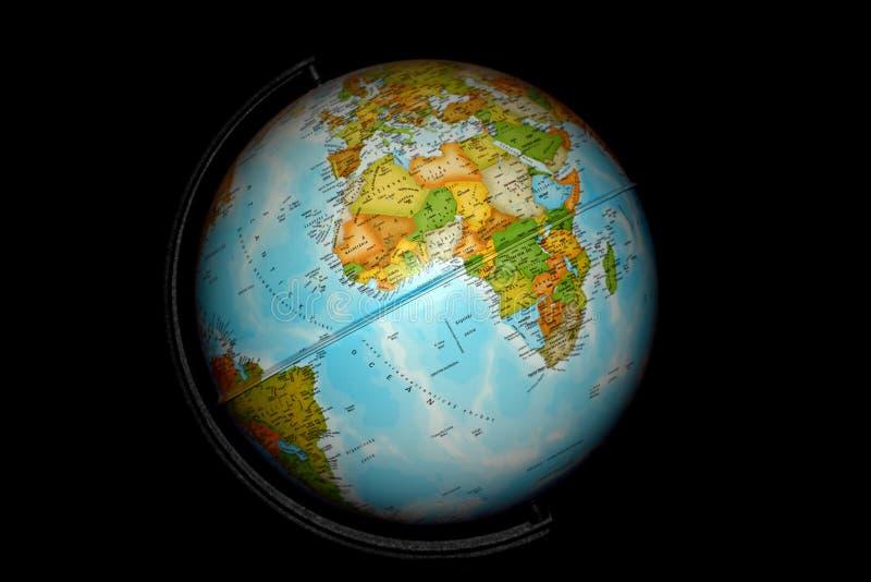 Desk globe on black. Africa and Atlantic Ocean on the globe; isolated on black stock photo