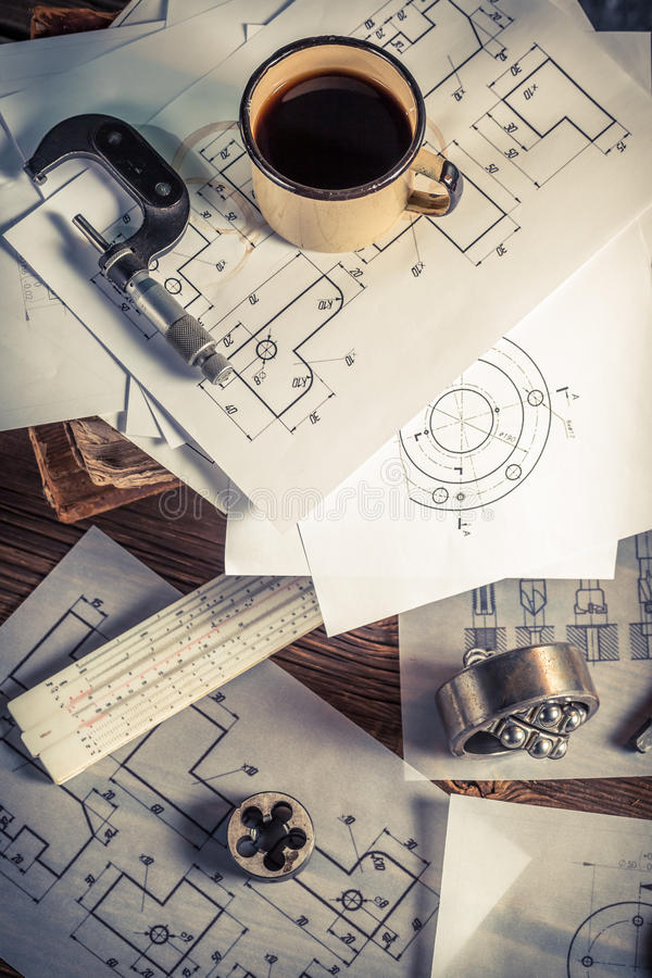 Desk hardworking engineer mechanical parts stock photography