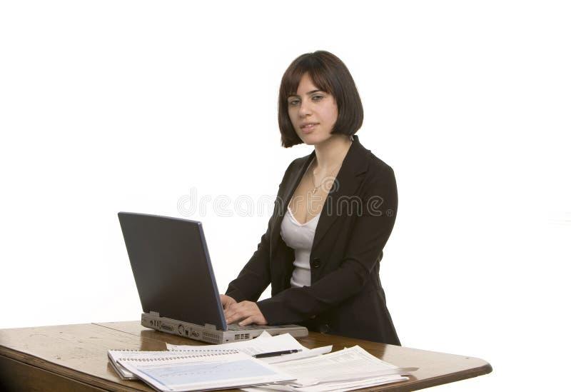 desk her side view woman στοκ εικόνες