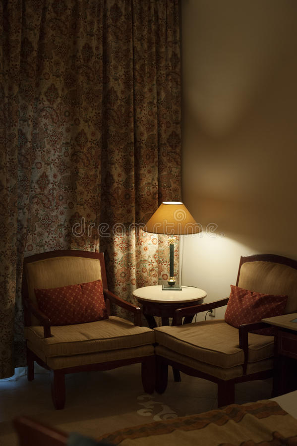 Desk lamp and two chairs in the room of hotel royalty free stock photo
