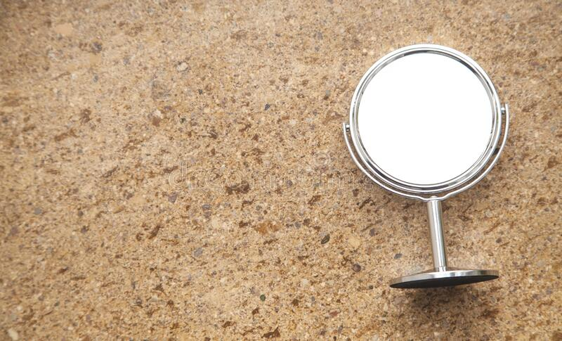 Desk mirror on a brown background stock image
