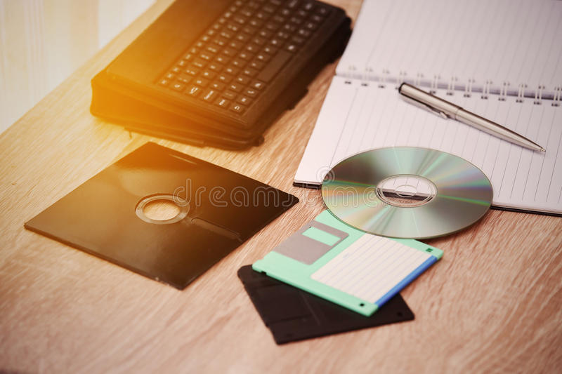 Desk with note ,floppy disk A, floppy disk B and memory drive in home office, private office and modern desk in modern life royalty free stock images