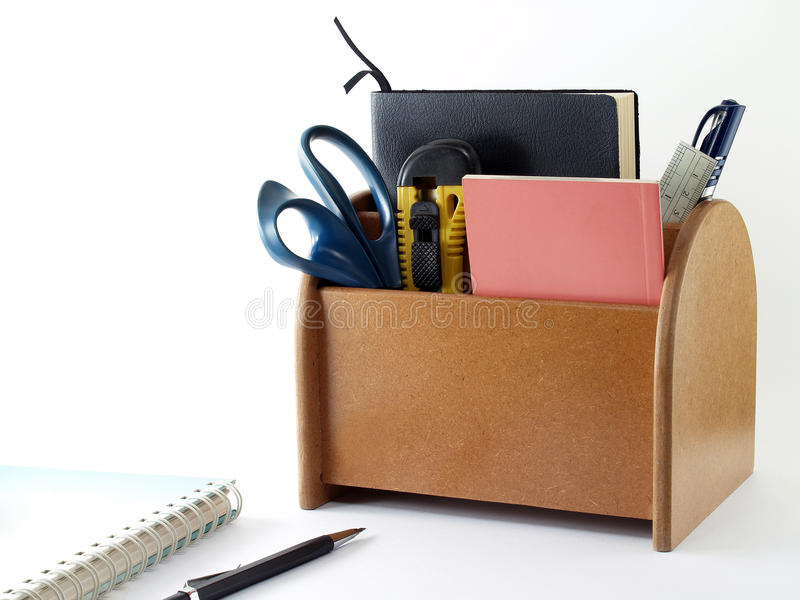 closeup brown plywood desk organizer with office supplies and stationery isolated on white background stock photography