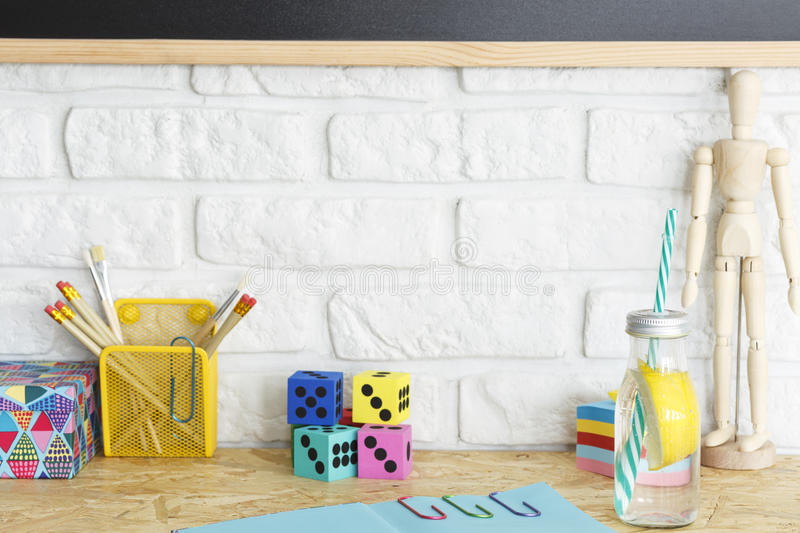 Desk with pencils, dices and sticky notes royalty free stock photos