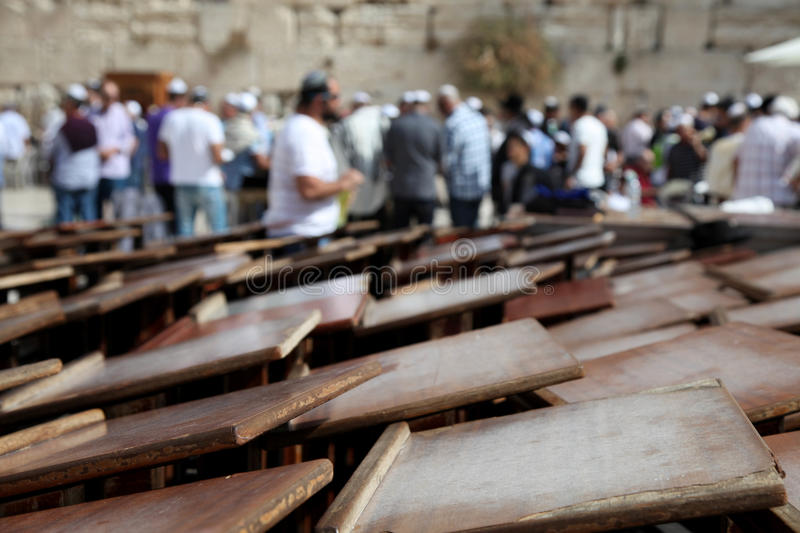 Desk and people at the wailing wall royalty free stock photography