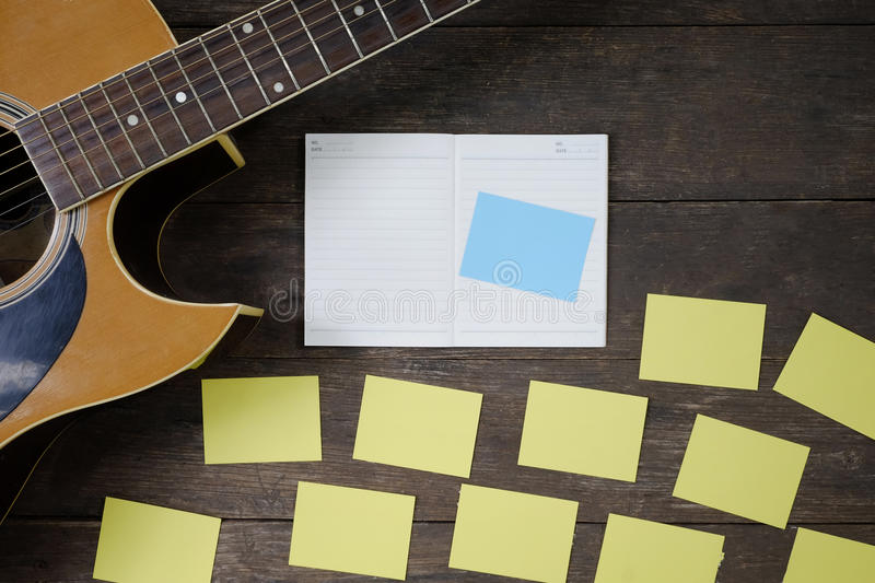 Desk of song composer for a work songwriter with a guitar. stock photography