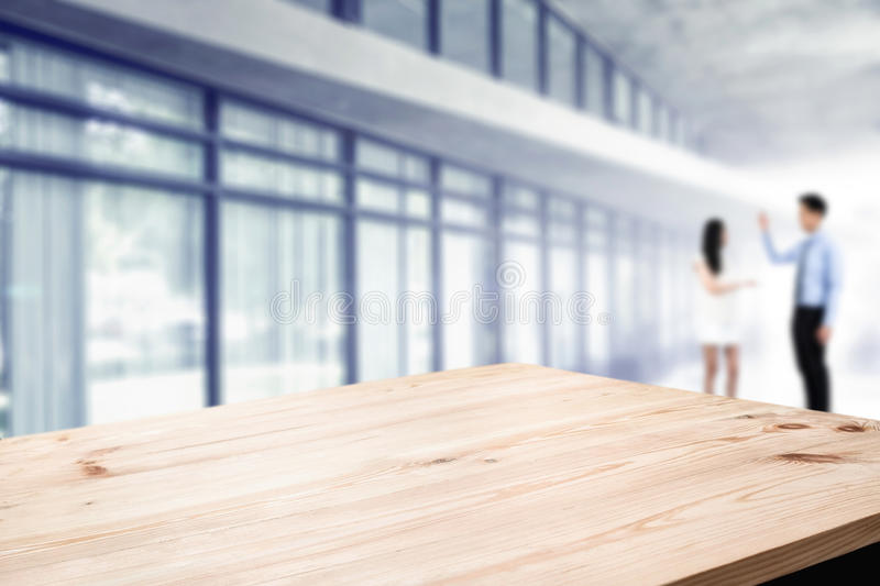 Desk space platform with business people at office. For product display montage. royalty free stock image