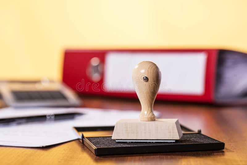 Desk with stamp and office material stock photos