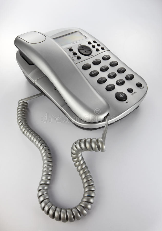Desk Telephone. A silver telephone isolated on white background