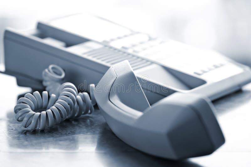 Desk telephone off hook stock photography