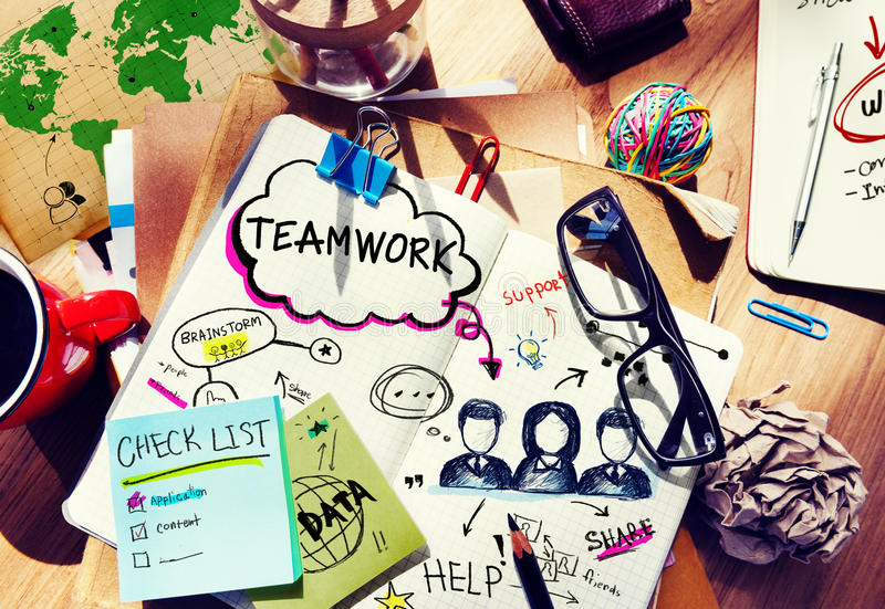 Desk with Tools and a Notebook with Ideas About Teamwork royalty free stock photos