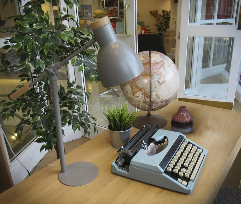 Desk with typewriter, lamp and globe. Old typewriter, lamp and globe on the desk stock photos