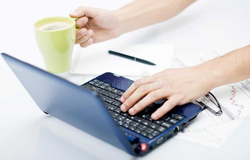 Desk work in front of computer with coffee on one royalty free stock image