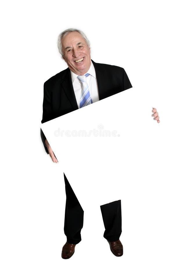 deskowego biały starszy gospodarstwa zdjęcia royalty free