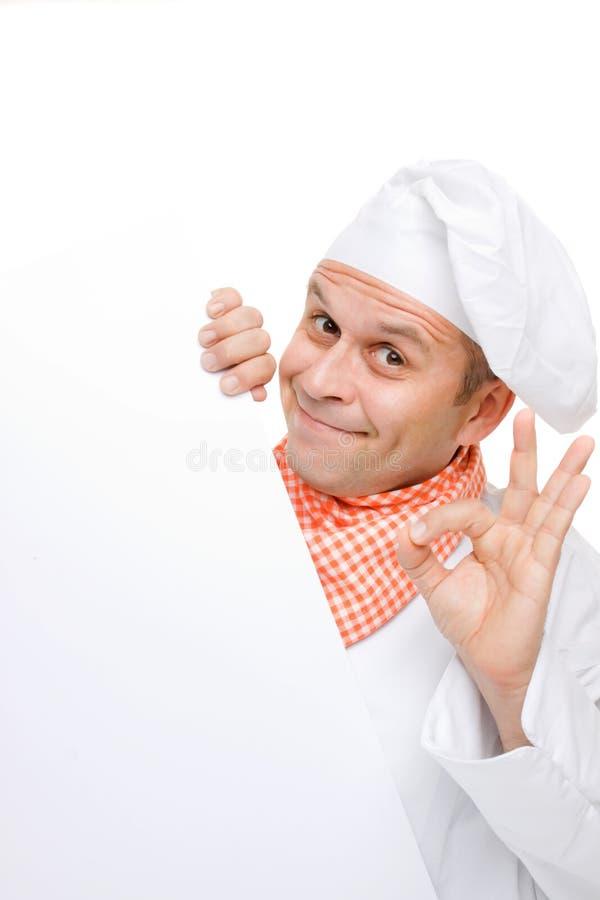 deskowy szef kuchni mienia info ja target417_0_ zdjęcia stock