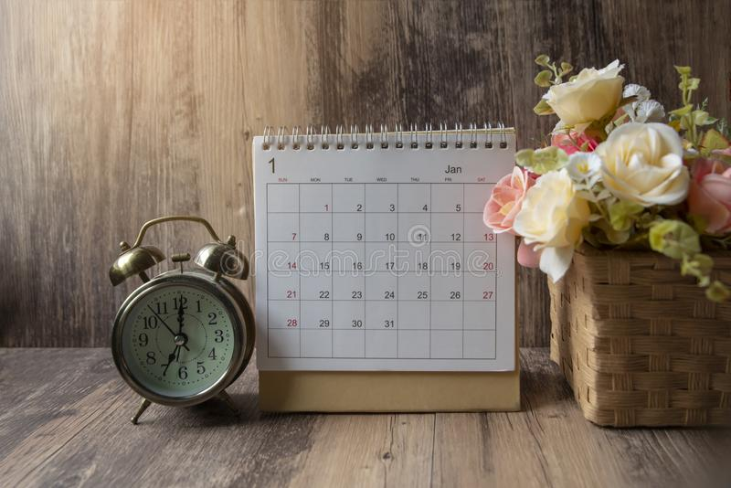 Desktop Calendar 2019 place on wooden office desk.Calender and clock for Planner timetable,agenda appointment,organization, royalty free stock image
