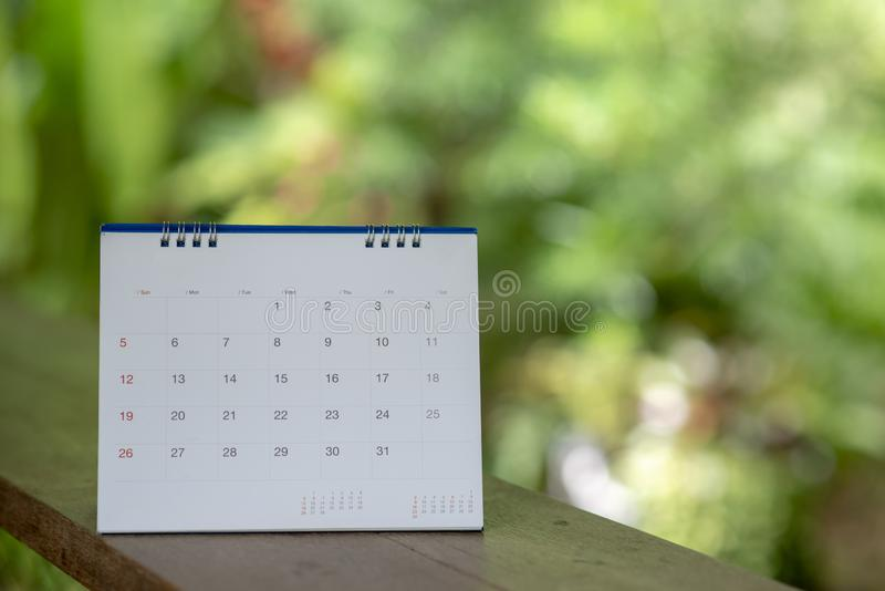Desktop Calendar 2019 place on wooden office desk.Calender for Planner to make timetable,agenda appointment,organization, royalty free stock photos