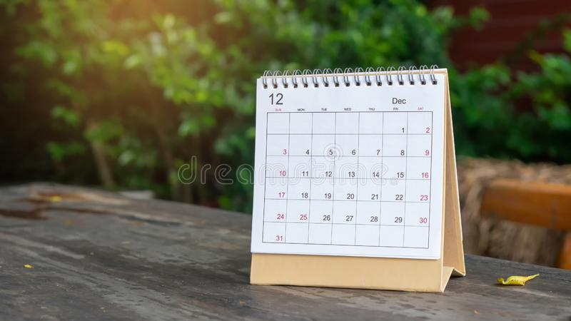 Desktop Calendar 2020. Place on wooden office desk,for Planner to make appointment each date,month and year on table.Calendar Background Concept stock photography