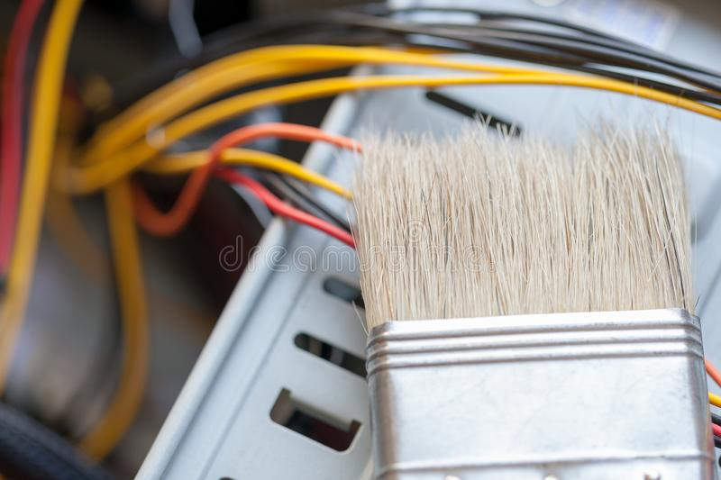 Desktop computer dust cleaning with tassel. computer power wires royalty free stock image