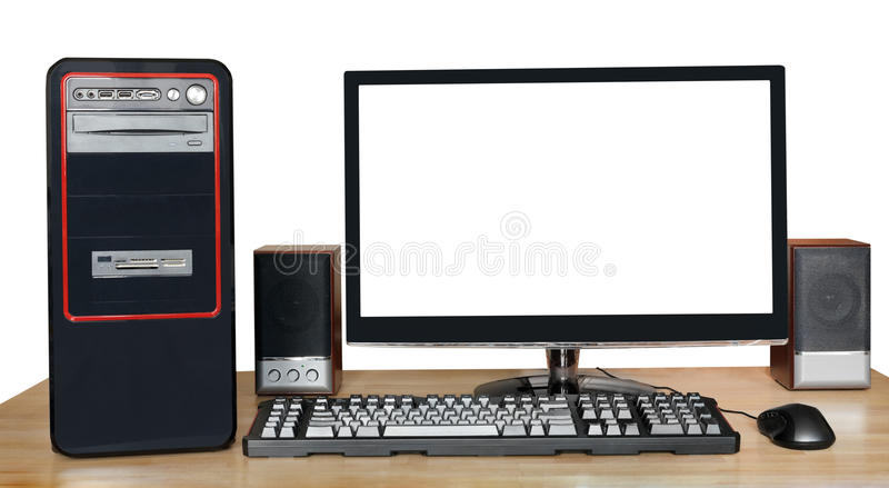 Desktop computer with widescreen display on table. Black desktop computer, widescreen display with cutout screen, keyboard, mouse, speakers on wooden table on stock images