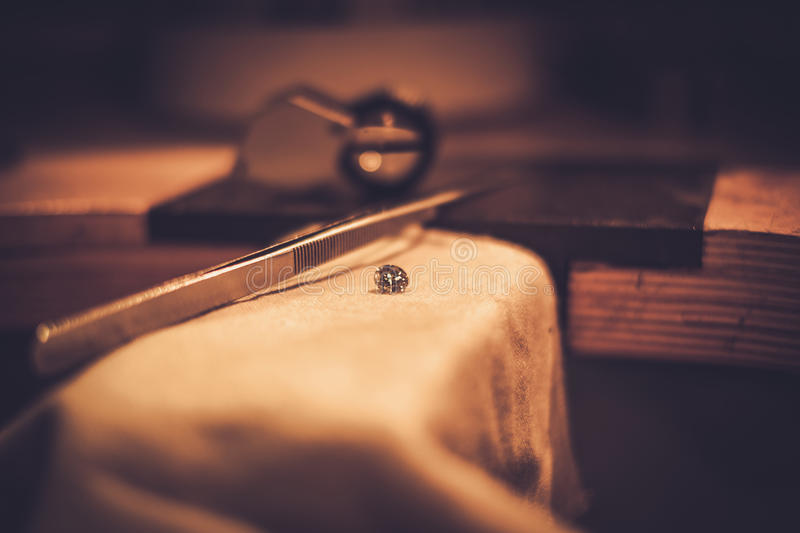 Desktop for craft jewellery making with professional tools.  stock photography