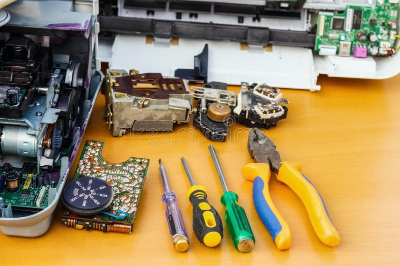 On the desktop is disassembled equipment and tools for repair. stock photo