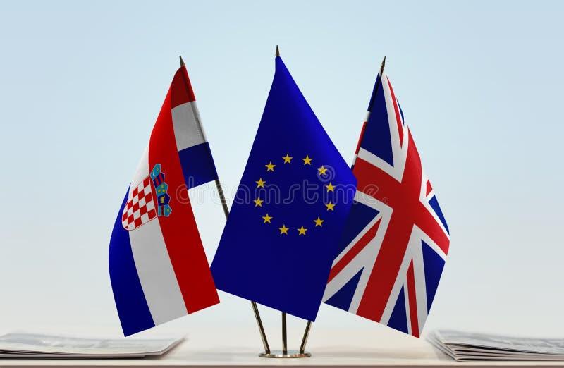 Flags of Croatia European Union and United Kingdom of Great Britain. Desktop flags of Croatia European Union and United Kingdom of Great Britain stock images