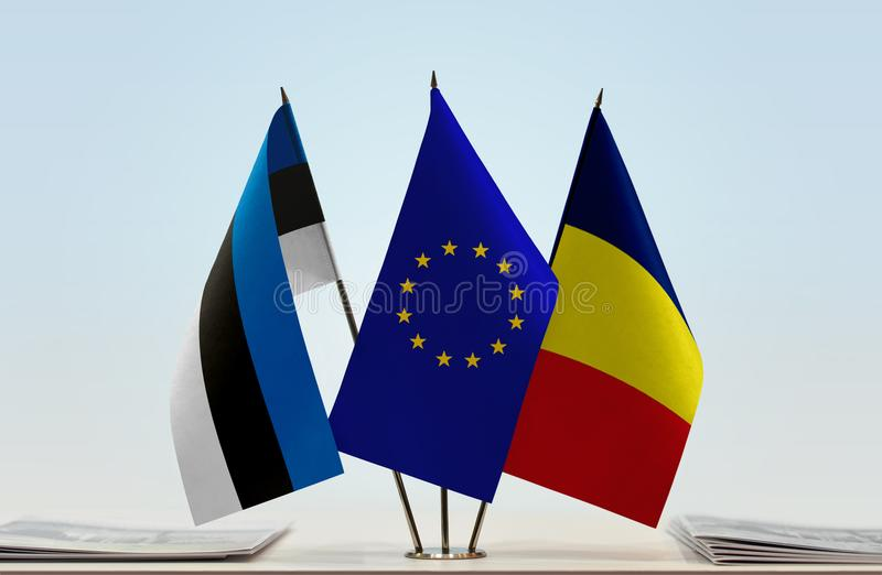 Flags of Estonia EU and Chad. Desktop flags of Estonia and Chad with European Union flag in the middle royalty free stock image