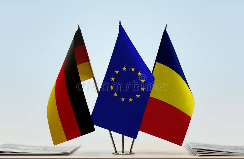 Flags of Germany EU and Chad. Desktop flags of Germany and Chad with European Union flag in the middle royalty free stock photos