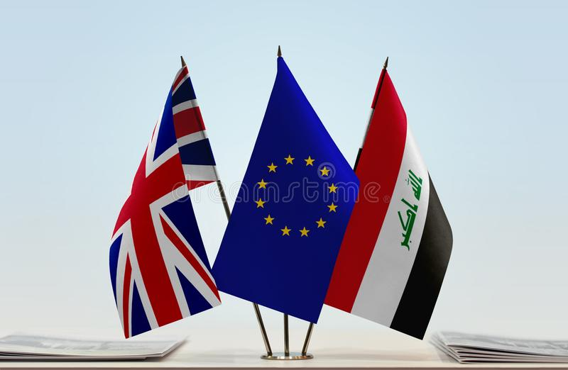 Flags of Great Britain EU and Iraq. Desktop flags of Great Britain and Iraq with European Union flag in the middle stock photos
