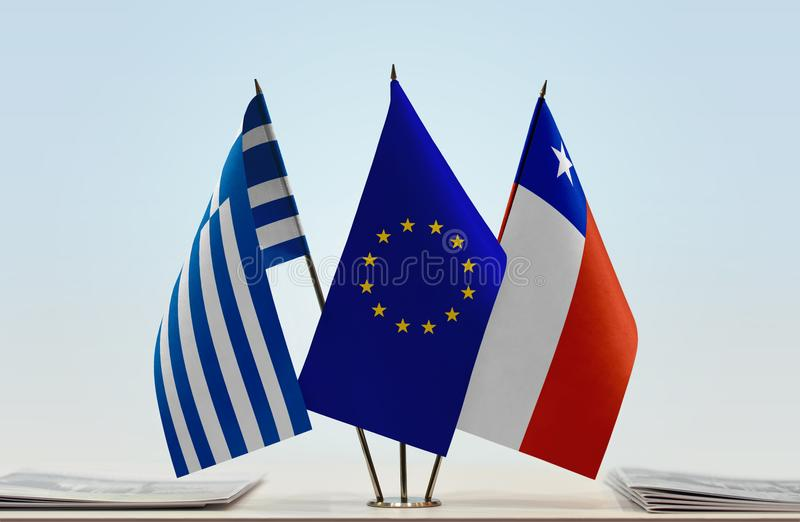 Flags of Greece EU and Chile. Desktop flags of Greece and Chile with European Union flag in the middle royalty free stock images
