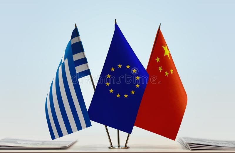 Flags of Greece EU and China. Desktop flags of Greece and China with European Union flag in the middle stock photos