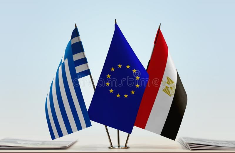 Flags of Greece EU and Egypt. Desktop flags of Greece and Egypt with European Union flag in the middle stock images
