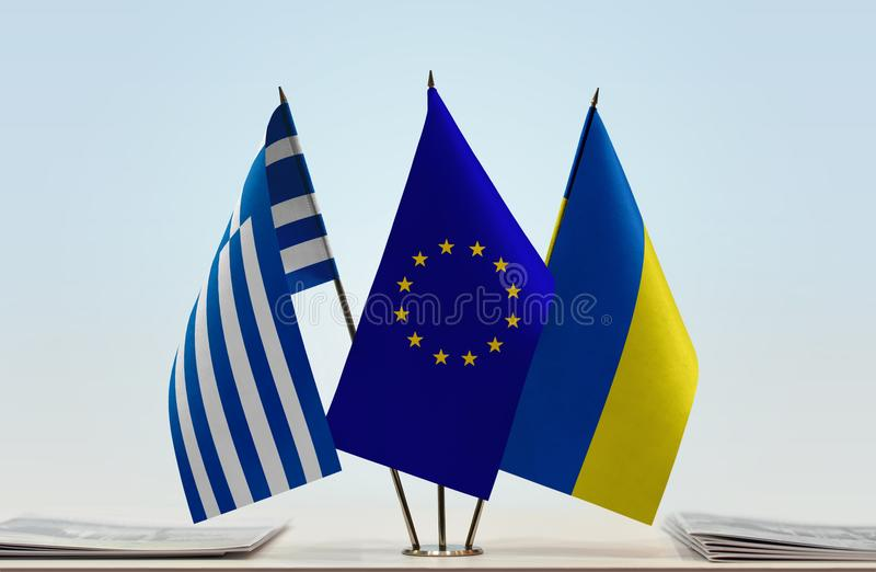 Flags of Greece European Union and Ukraine. Desktop flags of Greece European Union and Ukraine stock photography