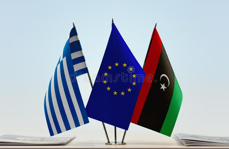 Flags of Greece EU and Libya. Desktop flags of Greece and Libya with European Union flag in the middle stock images