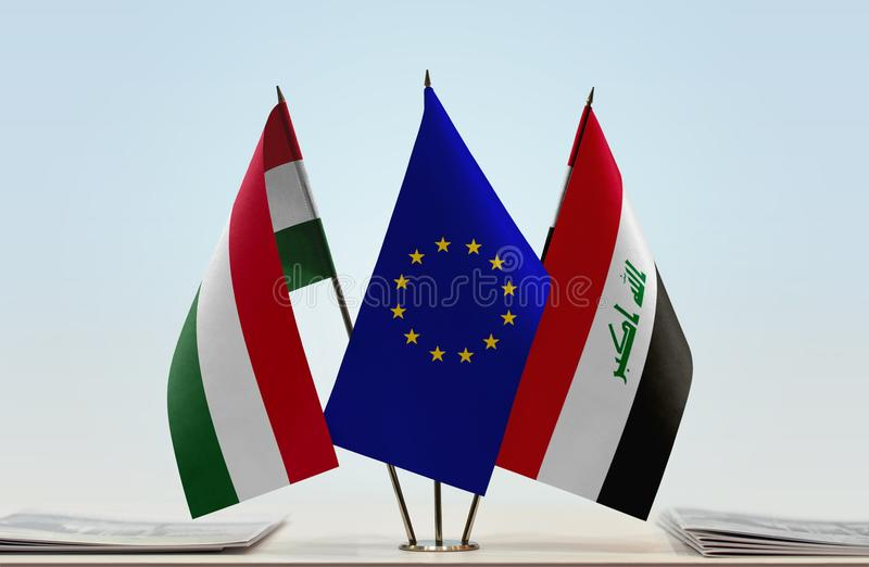 Flags of Hungary EU and Iraq. Desktop flags of Hungary and Iraq with European Union flag in the middle royalty free stock photography