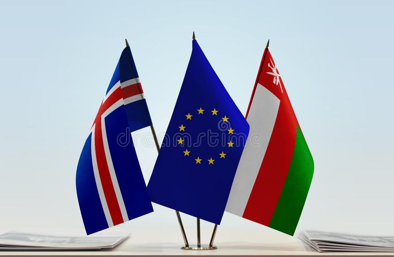 Flags of Iceland EU and Oman. Desktop flags of Iceland and Oman with European Union flag in the middle stock image