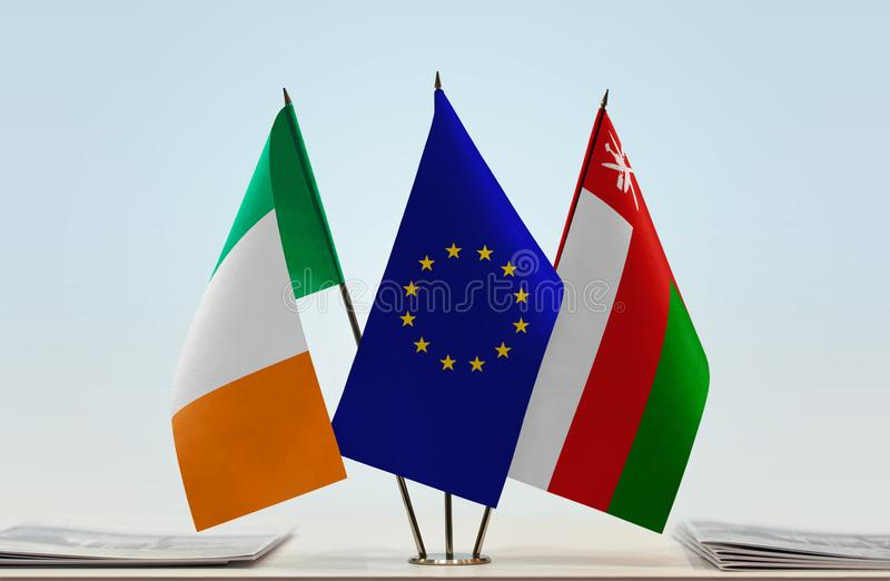 Flags of Ireland EU and Oman. Desktop flags of Ireland and Oman with European Union flag in the middle royalty free stock photos