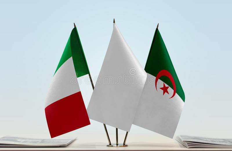 Flags of Italy and Algeria. Desktop flags of Italy and Algeria with white flag in the middle royalty free illustration