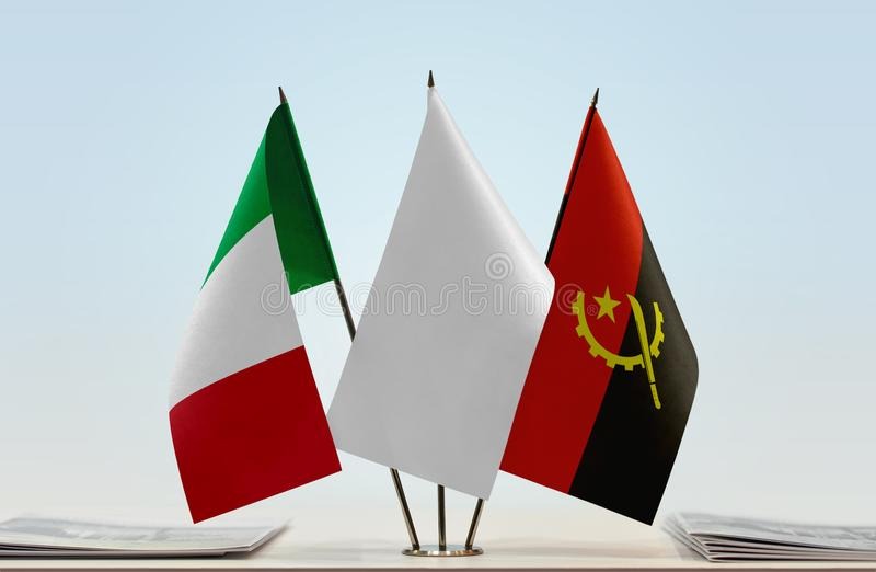 Flags of Italy and Angola. Desktop flags of Italy and Angola with white flag in the middle royalty free illustration