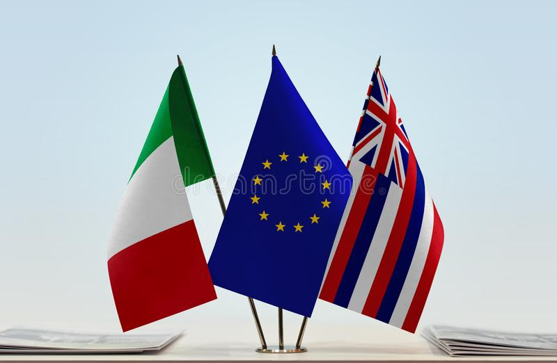 Flags of Italy EU and Hawaii. Desktop flags of Italy and Hawaii with European Union flag in the middle royalty free stock photos