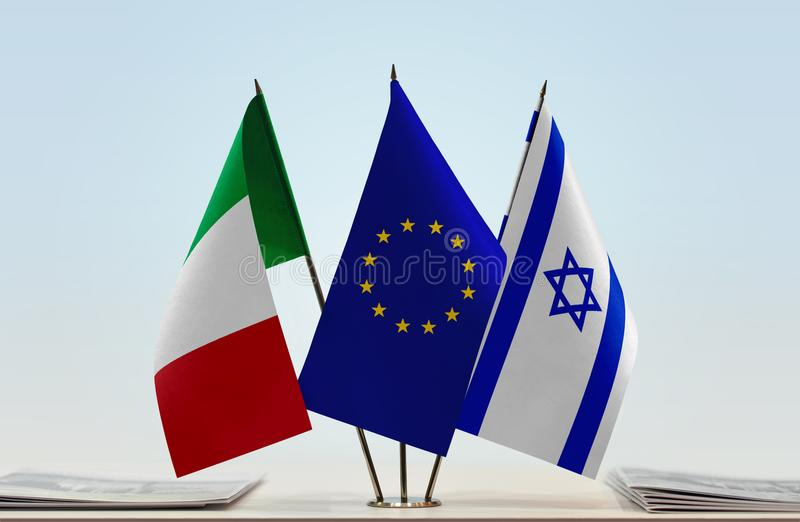 Flags of Italy EU and Israel. Desktop flags of Italy and Israel with European Union flag in the middle stock images