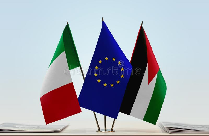 Flags of Italy EU and Jordan. Desktop flags of Italy and Jordan with European Union flag in the middle stock photos