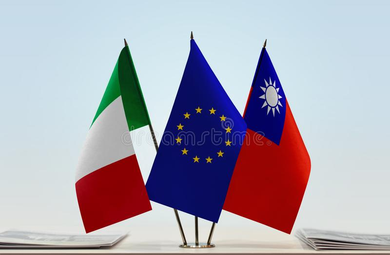 Flags of Italy EU and Taiwan. Desktop flags of Italy and Taiwan with European Union flag in the middle stock images